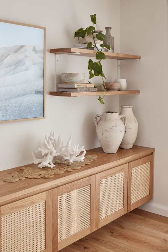 floating rattan cabinet, floating shelves, white wall, wooden floor
