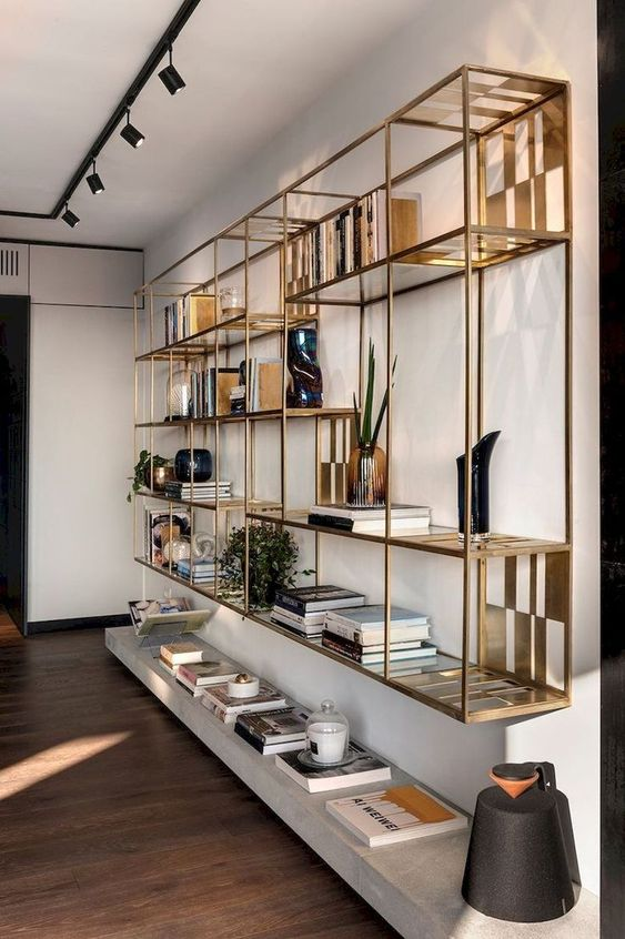 golden floating shelves with whte floating shelves under