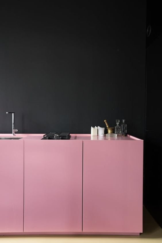 kitchen, black wall, pink bottom cabinet, pink counter top, wooden floor