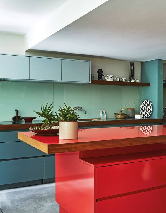 kitchen, grey seamless floor, green bottom cabinet, green backsplash, blue upper cabinet, white ceiling, red island