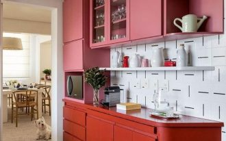 kitchen, grey seamless floor, white patterned backsplash, pink upper cabinet, red bottom cabinet