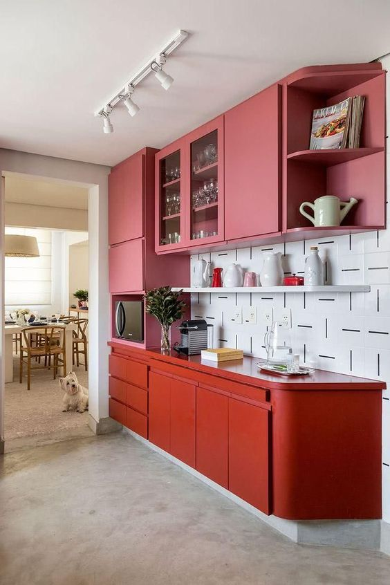 kitchen, grey seamless floor, white patterned backsplash, pink upper cabinet, red bottom cabinet