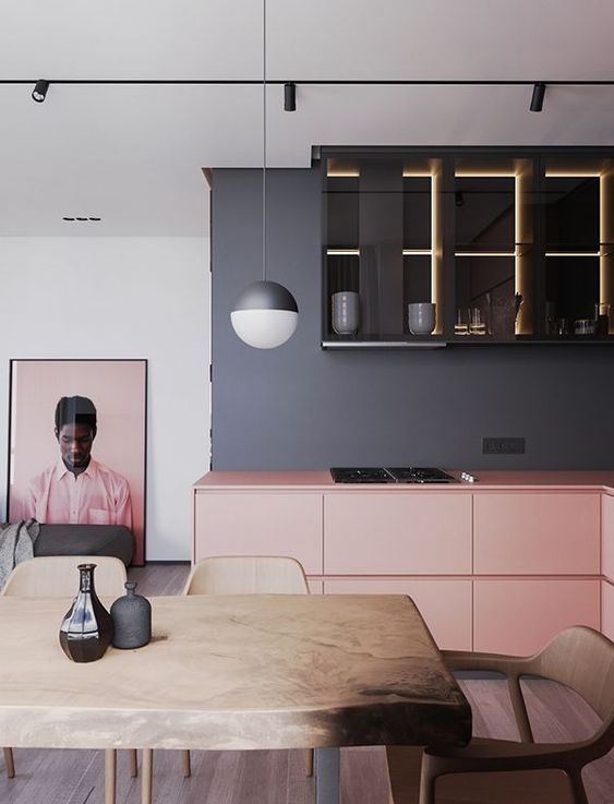 kitchen, pink bottom cabinet, grey wall, black upper cabinet, wooden table, wooden chairs