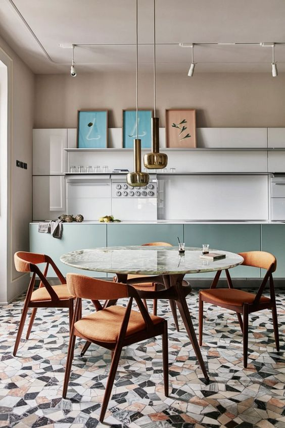 kitchen, white backsplash, brown wall, golden pendants, marble tulip table, brown wooden chairs, marble cuts floor tiels