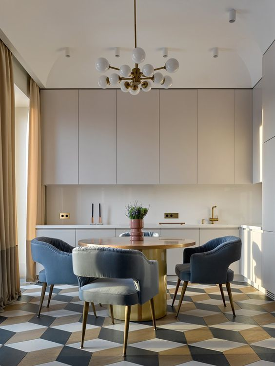 kitchen, white cabinet, whtie backsplash, white chandelier, wooden round table, blue chairs, hexagonal floor tiles