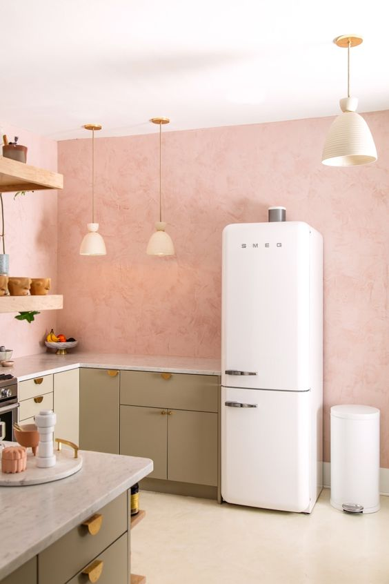 kitchen, white floor, soft pink wall, white fridge, soft green bottom cabinet, floating shelves