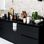Kitchen, White Wooden Floor, White Exposed Wall, Lack Sconces, Black Bottom Cabinet, Black Counter Top