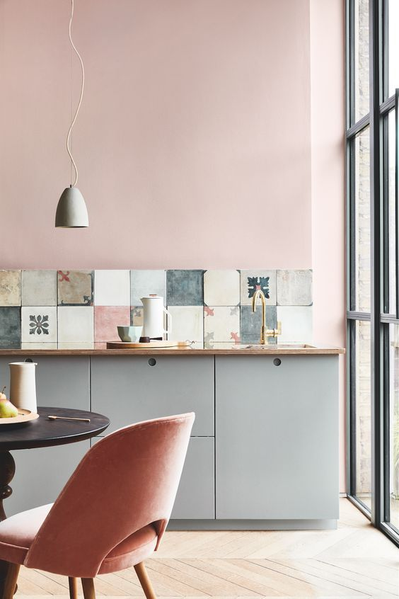 kitchen, wooden floor, grey bottom cabinet, white pendant, black round tulip table, pink chair