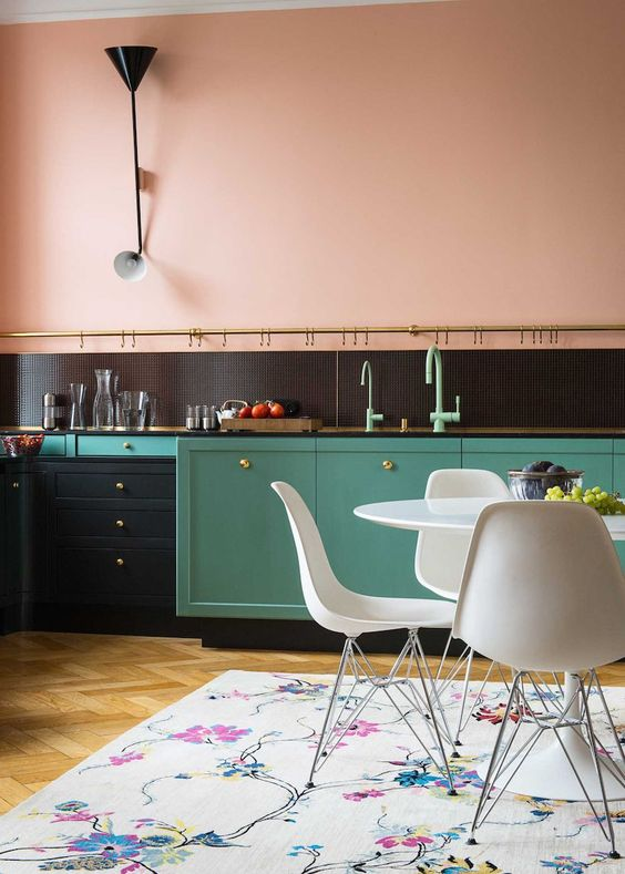 kitchen, wooden floor, soft peach wall, sconces, mint green cabinet, white tulip table, white modern chairs