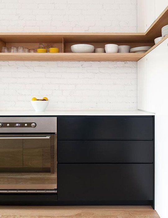 kitchen, wooden floor, white exposing wall, wooden shelves, black bottom cabinet