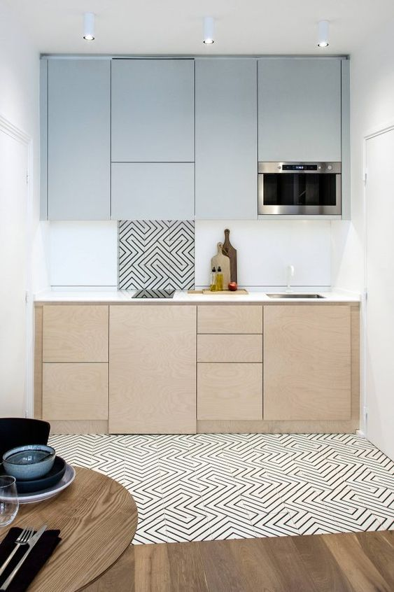 kitchen, wooden floor, white patterned floor, white wall, wooden cabinet, white backsplash, grey upper cabinet