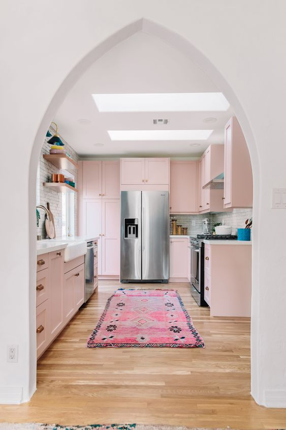 kitchen, wooden floor, white wall, soft pink shelves, pink rug