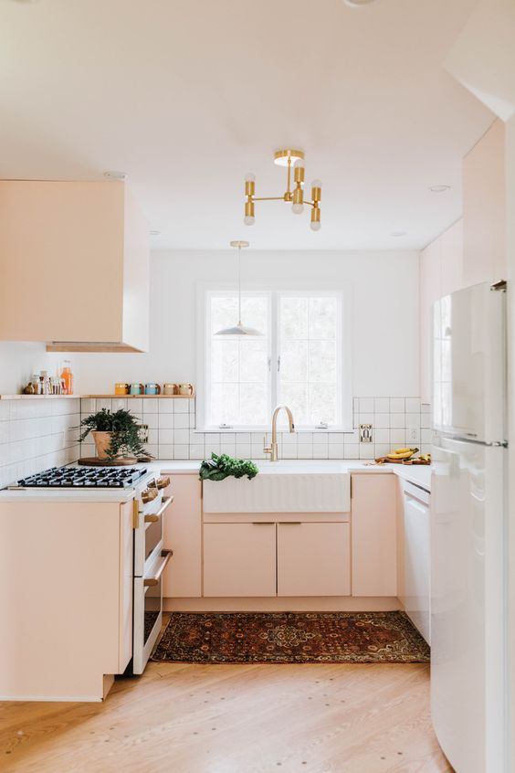 kitchen, wooden floor, white wall, white backsplash, white fridge, soft peach cabinet