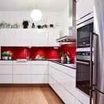 Kitchen, Wooden Floor, White Wall, White Cabinet, Red Backsplash, White Pendant