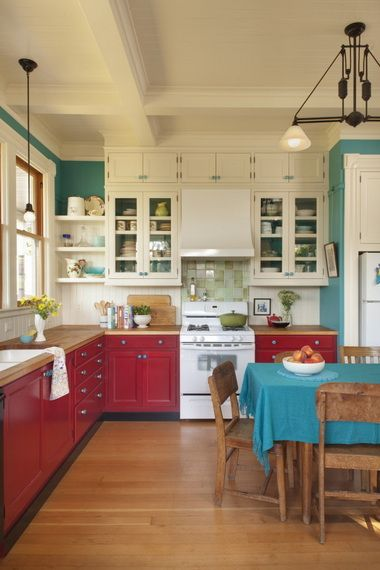 kitchen, wooden floor, white wall, white upper cabinet, red bottom cabinet, wooden top, wooden dinign set, black pendant
