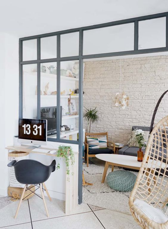 study, small table, black midcentury modern chair, white wall, white exposed wall, white floating shelves, white rug, white coffee table, grey sofa