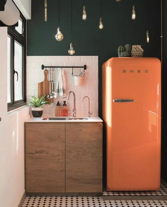 vintage kitchen, white wall, green wall, wooden cabinet, orange fridge, pendants, patterned floor