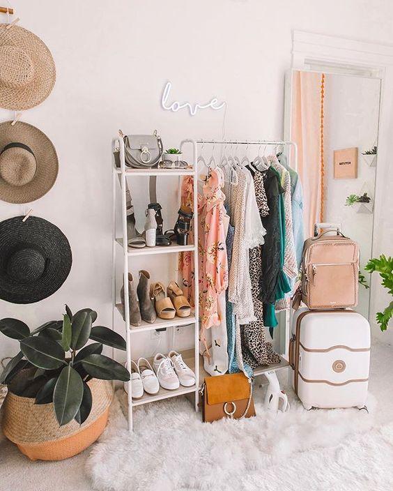 white metal rack, white shelves, white rug, white wall, rattan pot, suitcase