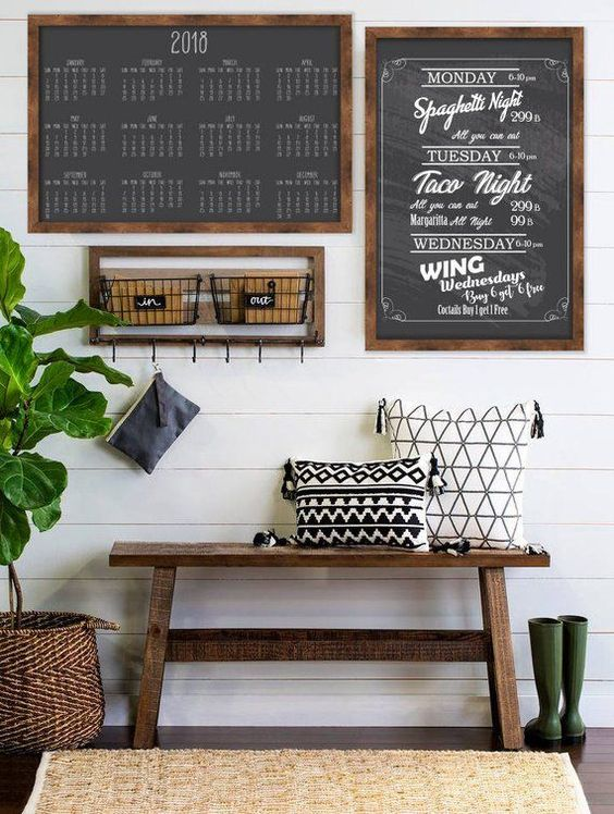 wooden bench, dark wooden floor, white wooden wall plank, blackboards, rattan rug, rattan pots