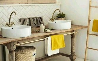 wooden vanity table, white wall, white herringbone backsplash tiles, bamboo rack, rattan basket, white wooden floor
