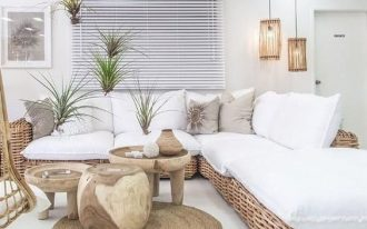 woven rattan corner bench, white cushion, white pillows, white seamless floor, wooden round tray table, pendant