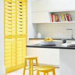 Yellow Lime Window Shutters, White Wall, White Floating Cabinet, White Bottom Cabinet, Yellow Stools, Black Counter Top