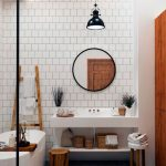 Bathroo, Grey Floor, White Wall, White Wall Tiles, White Vanity, White Tub, Round Mirror, Black Pendant