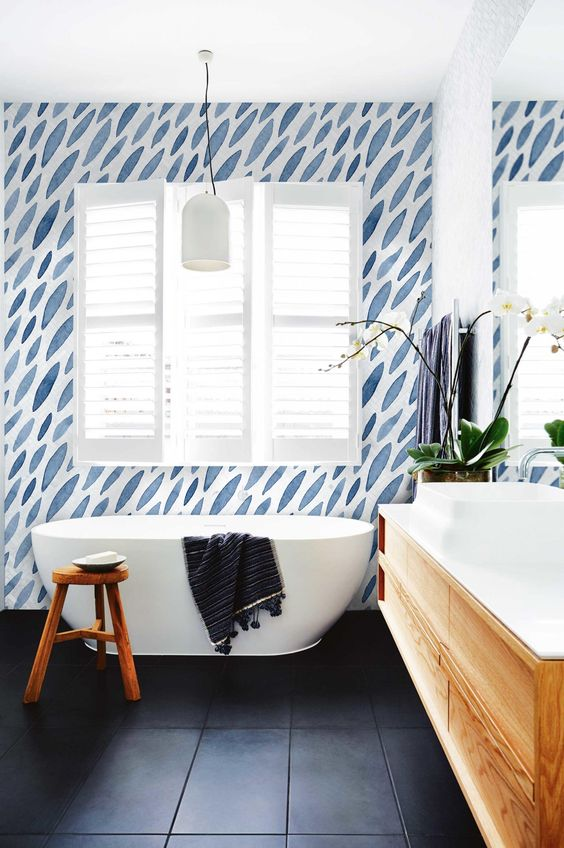 bathroom, black floor, white wall, white ceiling, blue white accent wall, wooden floating vanity, white sink