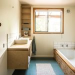 Bathroom, Blue Rubber Flooring, Brown Wall, Wooden Tub, White Tub, Floating Wooden Cabinet, Window
