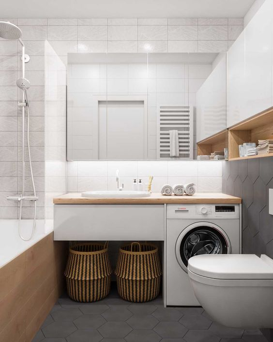 bathroom, grey hexagonal floor tiles, white floating toilet, white floating vanity wooden counter top, white upper cabinet, wooden looking white tub