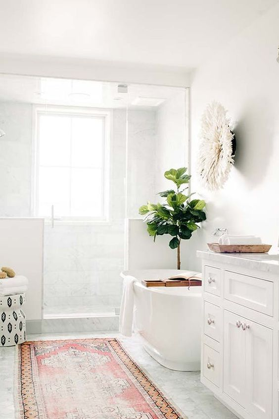 bathroom, off white floor, white wall, wite tub, white cabinet, white tiles