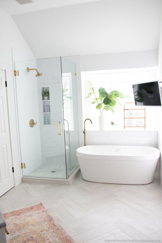 bathroom, white ceiling, white wall, white tub, glass partition, white herringbone floor