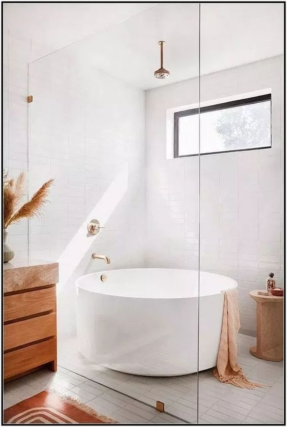 bathroom, white floor tiles, white subway wall tiles, white round tub, wooden cabinet, golden pendant