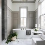 Bathroom, White Marble Floor, White Wall, Grey Wainscoting Wall, White Tub, White Chair,