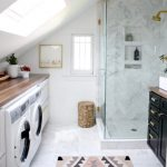 Bathroom, White Marble Floor, White Wall, Vaulted Ceiling, Ceiling Window, Laundry Machine, White Marble Wall, Black Cabinet