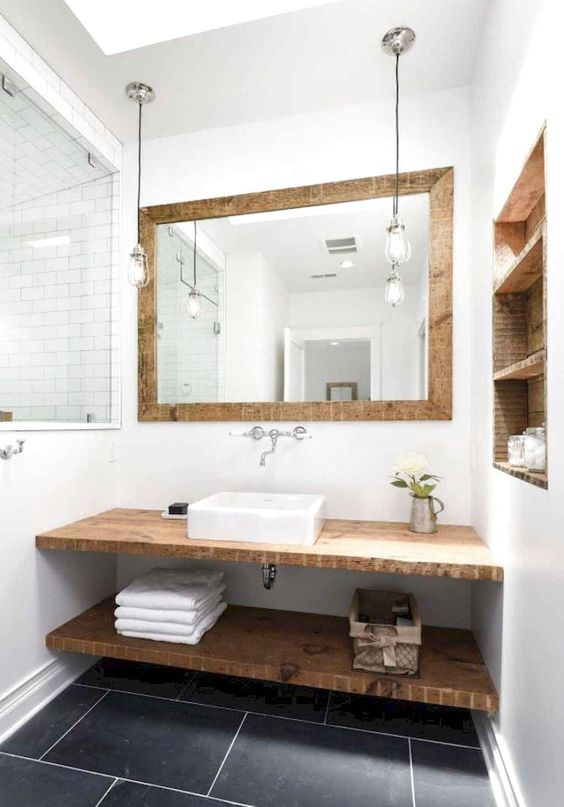 bathroom, white wall, wooden framed mirror, pendants, wooden floating vanity and shelves, wooden indented shelves