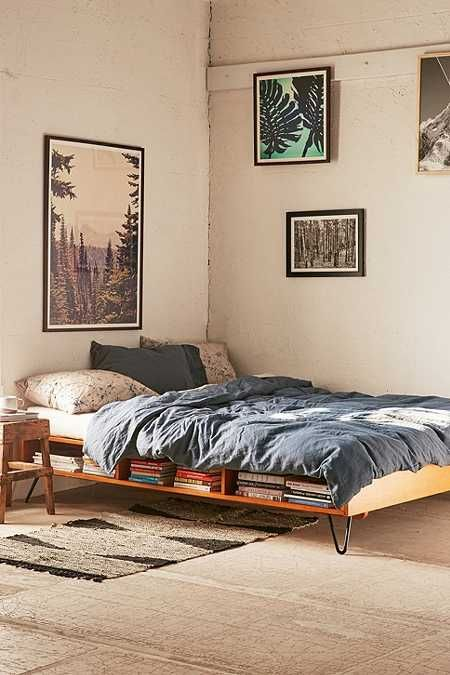 bed platform, metal legs, shelves, brown rug, cream wall, wooden stools