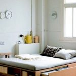 Bed Platform, Wooden Material, Shelves, Drawers, White Wall, Wooden Floor, Grey Rug