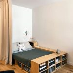 Bed Platform, Wooden Material, Shelves On The Side And Feet At The Bed, Wooden Floor, White Wall, Curtain