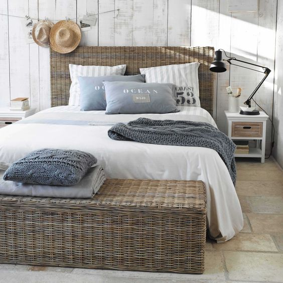 bedroom, stone floor, white wooden wall, rattan bed platform, rattan bench, white wooden bedside shelves, white ebdding