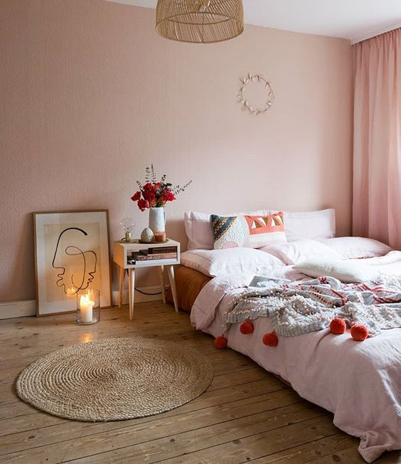 bedroom, wooden floor, round rattan rug, pink wall, pink curtain, rattan pendant