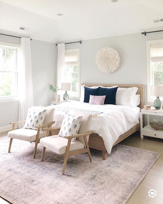 bedroom, wooden floor, white wall, wooden bed platform, wooden chairs, white cushion, white bedding, white side cabinet, purple rug