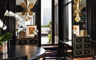 black dining room, wooden floor, black rug, black cabinet, black dining table, black chairs