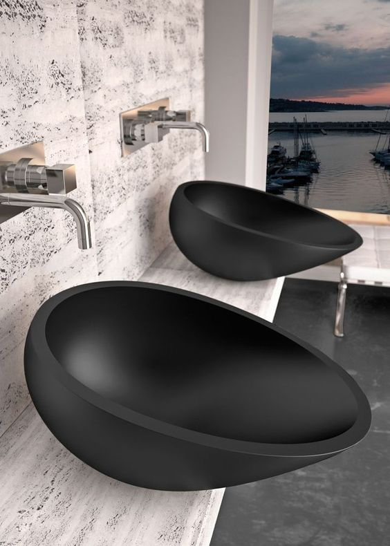 black moder sink, white marble vanity, white marble wall