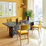 Black Terrazzo Table, Wooden Floor, Yellow Chairs, Yellow Wall, Yellow Glass Pendant