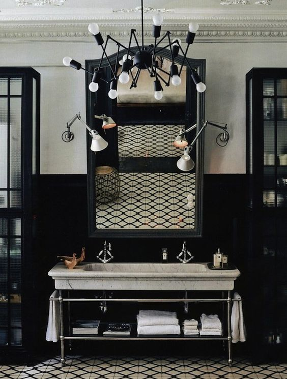 black wainscoting, white wall, white detailed ceiling, white marble long sink, black white patterned floor, black cabinet