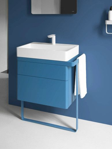 blue cabinet, white sink, one furniture, blue background, mirror