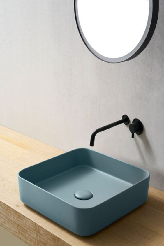 blue square sink, wooden floating vanity, round mirror, black faucet