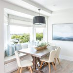Breakfast Nook, Wooden Floor, White Wall, White Bench, Brown Cushion, Blue Pillows, White Shade, Black Pendant, Wooden Table, White Chairs
