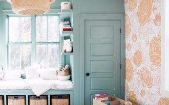 children's bedroom, brown rug, green shelves, green framed window, green cupboard, rattan pendant, orange flower pattern wall